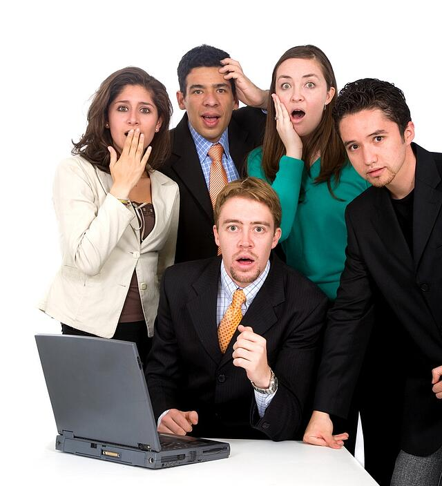 business team looking shocked and stressed - isolated over a white background.jpeg