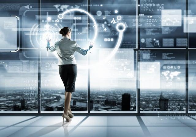Image of businesswoman pushing icon on media screen.jpeg
